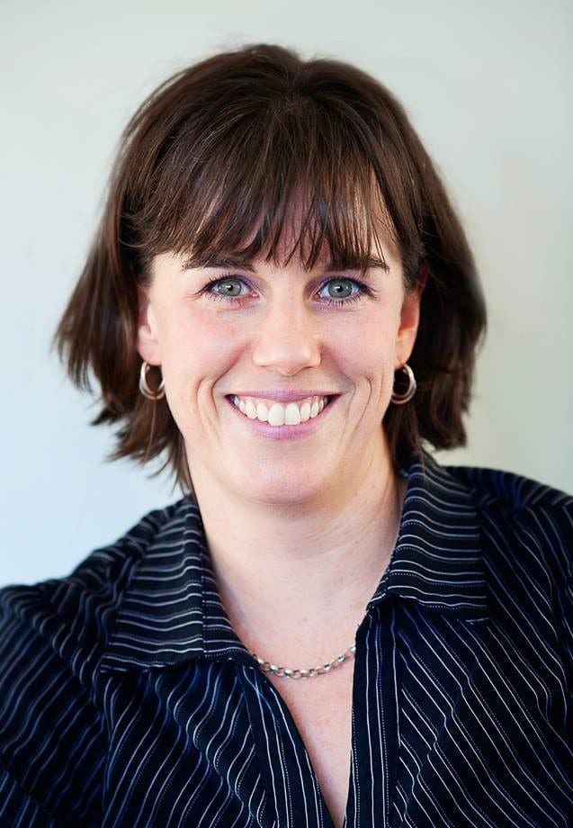 Photograph of Daria Williamson, coach, facilitator and trainer. She is a woman with short, dark hair