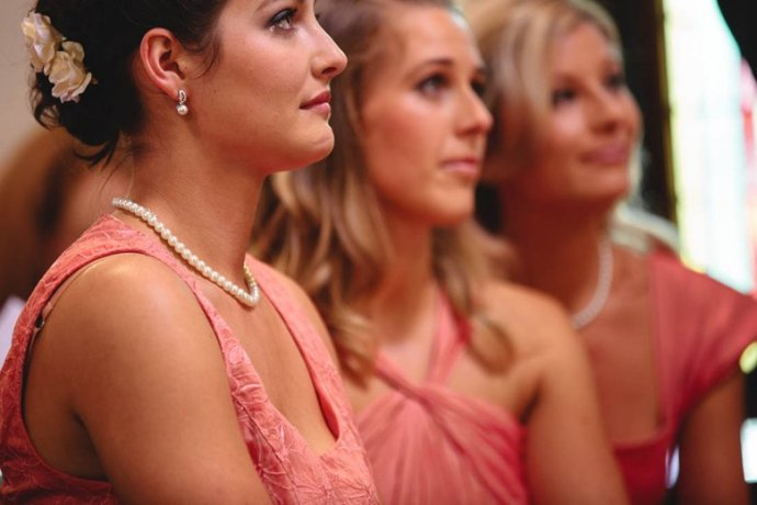 The bridesmaids look on