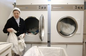 """Sister Gloria Moura takes care of the laundry needs for the sisters at the monastery. SUMMARY: """"LIFE INSIDE THE IMMACULATA MONASTERY"""" """"So faith, hope, love remain, these three: but the greatest of these is love."""" -- 1st Corinthians 13:13. The 40 Benedictine sisters of the Immaculata Monastery in Norfolk live by that Bible verse. They start and end each day with prayer. These images are just a small glimpse into their lives."""