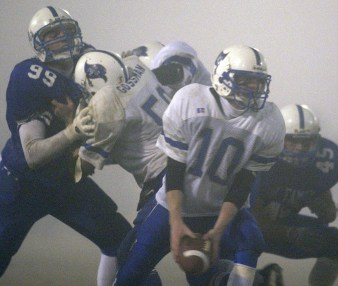 Matt Parks of Elgin Pope John (10) looks to pitch the ball as heavy fog limits visibility during playoff action against Lindsay Holy Family Saturday night, Nov. 16, 2002.