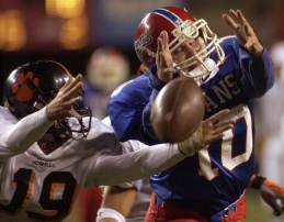 Mat Eikmeier (19) of Howells and Ricky Rech of Greeley/Wolbach both reach for a pass intended for Rech during the class D1 state championship game Thursday night, Nov. 21, 2002. The ball fell incomplete.
