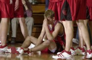 Jeremiah Nolze of Clearwater sits on the floor dejected after the final buzzer sounded marking the end of their season following their loss to Beemer in the class D2-2 district championship Tuesday night, Feb. 26, 2002.