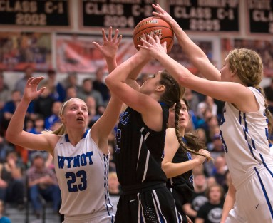 DARIN EPPERLY/DAILY NEWS -- NORFOLK -- Allison Brennan of Ponca finds herself in a tight position while shooting between Wynot's Cortney Arkfeld (23) and Julie Eskens during the Lewis & Clark Conference championship game on Monday night in Laurel. 2-6-17