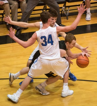 DARIN EPPERLY/DAILY NEWS LINCOLN -- Trevor Pfeifer (34) and Pierce Eisenmenger of Humphrey St. Francis apply full court pressure on Daniel Young of Mullen during their first round game at Lincoln Southeast on Thursday in Lincoln. 3-9-17