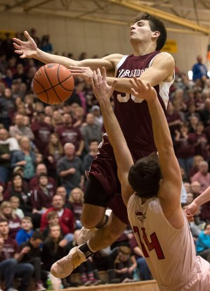 DARIN EPPERLY/DAILY NEWS LINCOLN -- Tyson Belitz of Neligh-Oakdale is fouled by Holden Eckhout of Amherst during their first round game at the Lincoln Southeast in Lincoln on Thursday afternoon. 3-9-17