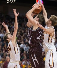 DARIN EPPERLY/DAILY NEWS LINCOLN -- Matthew Hagedorn of Norfolk takes a shot as Papillion-LaVista's Caleb Feekin (left) and Peyton Priest defend during the Class A championship game on Saturday night at Pinnacle Bank Arena. 3-11-17