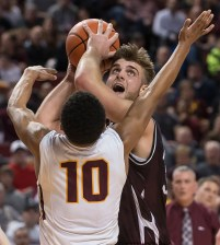 DARIN EPPERLY/DAILY NEWS LINCOLN -- Logan Strom of Norfolk takes a shot as Ayo Akinwole of Papillion-LaVista defends during the Class A championship game on Saturday night at Pinnacle Bank Arena. 3-11-17