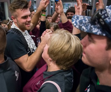 DARIN EPPERLY/DAILY NEWS LINCOLN -- Logan Strom of Norfolk greets fans in the concourse at the Pinnacle Bank Arena after the Panthers won the Class A championship game on Saturday night. 3-11-17