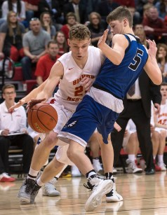 DARIN EPPERLY/DAILY NEWS LINCOLN -- Wyatt Liewer of O'Neill tries to avoid fouling Jaxon Simons of Bishop Neumann during their first round game at the Devaney Sports Center in Lincoln on Thursday afternoon. 3-9-17