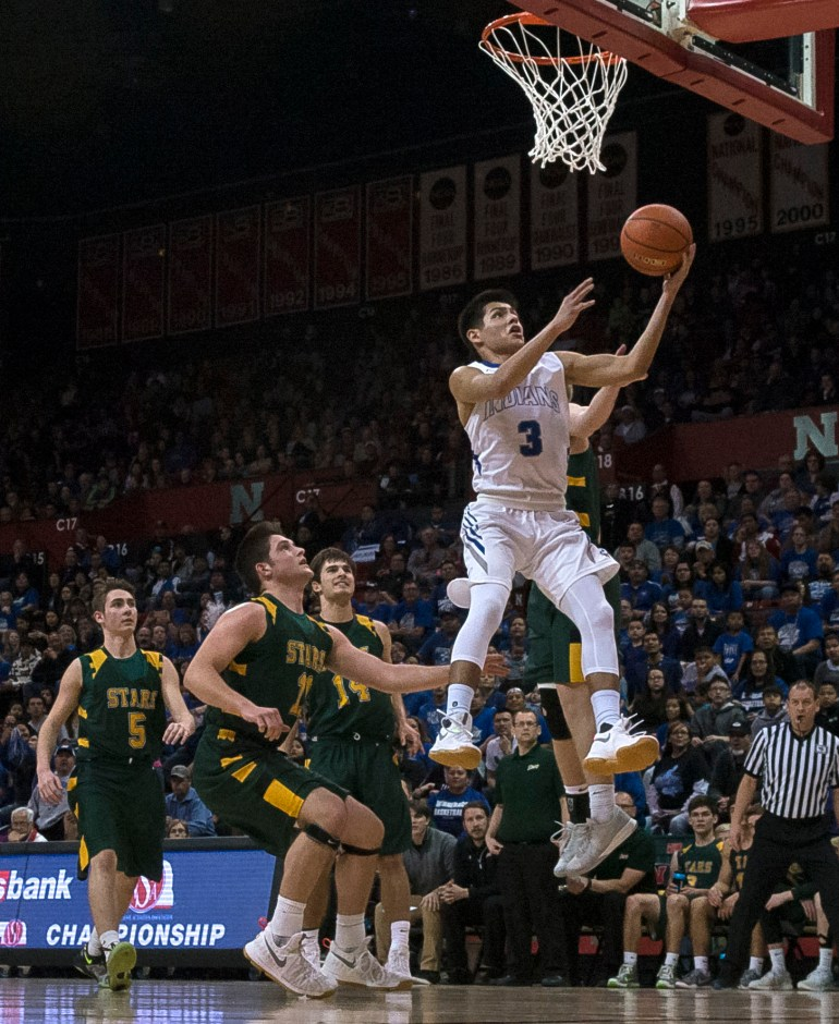 DARIN EPPERLY/DAILY NEWS LINCOLN -- Drake Gorrin of Winnebago gets inside for an easy basket against Kearney Catholic during their first round game at the Devaney Sports Center on Thursday morning in Lincoln. 3-9-17