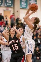 DARIN EPPERLY/DAILY NEWS LINCOLN -- Emily Reeson of West Point Guardian Angels Central Catholic pulls up for a shot as Erin Johnson of Meridian guards her during their first round Class D1 game at Lincoln Southwest on Thursday morning. 3-2-17