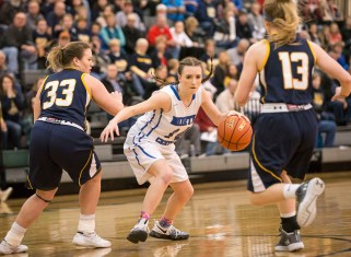 DARIN EPPERLY/DAILY NEWS LINCOLN -- Skylar Cosgrove of North Central looks for a way past Elm Creek's Madison Halliwell (33) and Taylor Goedert (13) during their first round Class D1 game at Lincoln Southwest on Thursday. 3-2-17