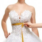 bride-getting-measured-for-her-bridal-gown-150x150