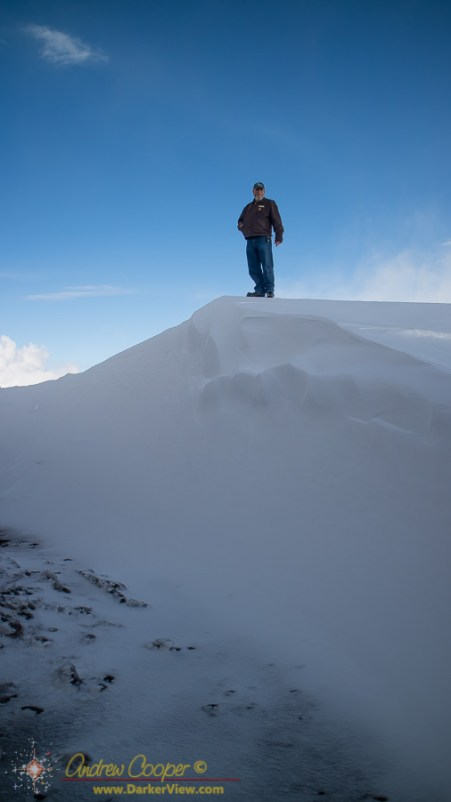 Eric gives scale to a rather large snowdrift in front of Keck Observatory