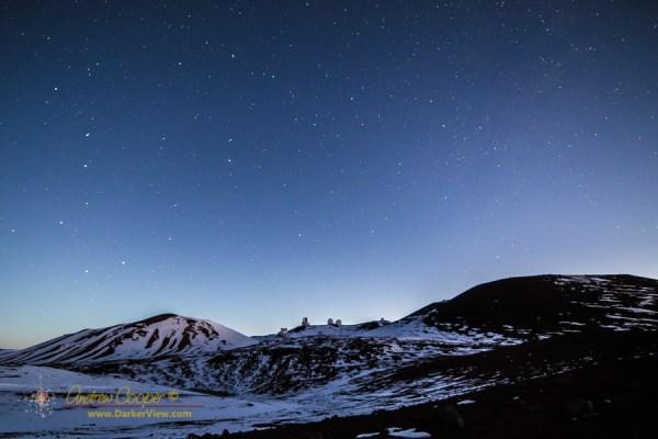 The telescopes of Mauna Kea on a snowy dawn