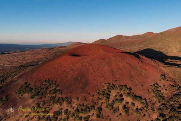 The bright red Puʻu Kole, site of the last eruption on Mauna Kea four thousand years ago
