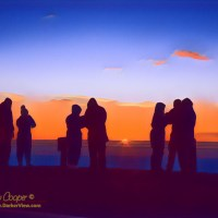 A crowd of tourists watching sunrise atop Mauna Kea