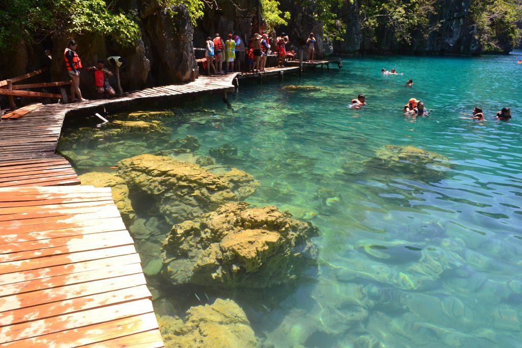 Swimming in clear water at Kayangan Lake