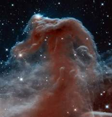 This new Hubble image, captured and released to celebrate the telescope's 23rd year in orbit, shows part of the sky in the constellation of Orion (The Hunter). Rising like a giant seahorse from turbulent waves of dust and gas is the Horsehead Nebula, otherwise known as Barnard 33. This image shows the region in infrared light, which has longer wavelengths than visible light and can pierce through the dusty material that usually obscures the nebula's inner regions. The result is a rather ethereal and fragile-looking structure, made of delicate folds of gas — very different to the nebula's appearance in visible light.
