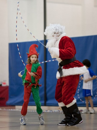 Anna Lawson (left), 9, playing an elf while jumping rope with Santa played by Max Gleichauf, 15. The Kangaroo Kids holiday hop with jumping Santa was held at the Gary J. Arthur Community Center in Cooksville on December 11, 2010. (Nate Pesce/Patuxent Publishing)