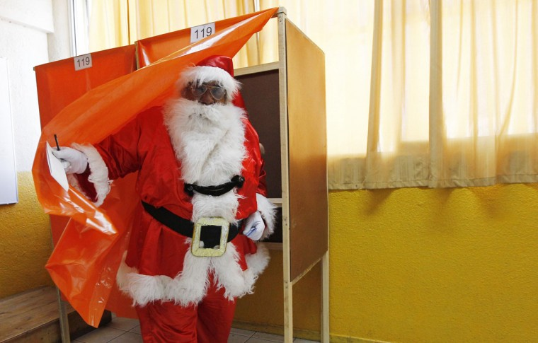 Rigoberto Martinez, 63, dressed as Santa Claus, casts his vote during municipal elections in Valparaiso city, about 121 km (75 miles) northwest of Santiago, October 28, 2012. Martinez said he has dressed as Santa Claus in all elections since Chile's return to democracy in 1990 from the 17-year dictatorship of Augusto Pinochet. (Eliseo Fernandez/Reuters)