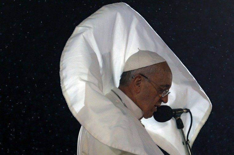 Pope Francis addresses the young people at Copacabana beach in Rio de Janeiro, Brazil during the World Youth Day on July 25, 2013. The first Latin American and Jesuit pontiff arrived in Brazil mainly for the huge five-day Catholic gathering World Youth Day. On the fourth day of his visit to Brazil and borne along by adoring crowds, Pope Francis waded into the country's ramshackle slums and onto the front line of its fierce national battle over poverty and corruption, before going to the much wealthier district of Copacabana. (Stefano Rellandini/AFP/Getty Images)