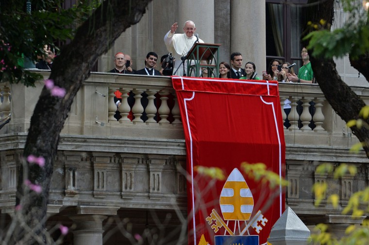 Pope Francis waves at the crowd from a balcony of the San Joaquin Episcopal Palace in Rio de Janeiro, Brazil, after delivering the Angelus prayer on July 26, 2013. Pope Francis met young convicts here and will later return to Copacabana beach Friday where 1.5 million Catholics gathered on Rio de Janeiro's seafront to see him speak the previous night in a massive ceremony for World Youth Day festivities. (Yasuyoshi Chiba/AFP/Getty Images)