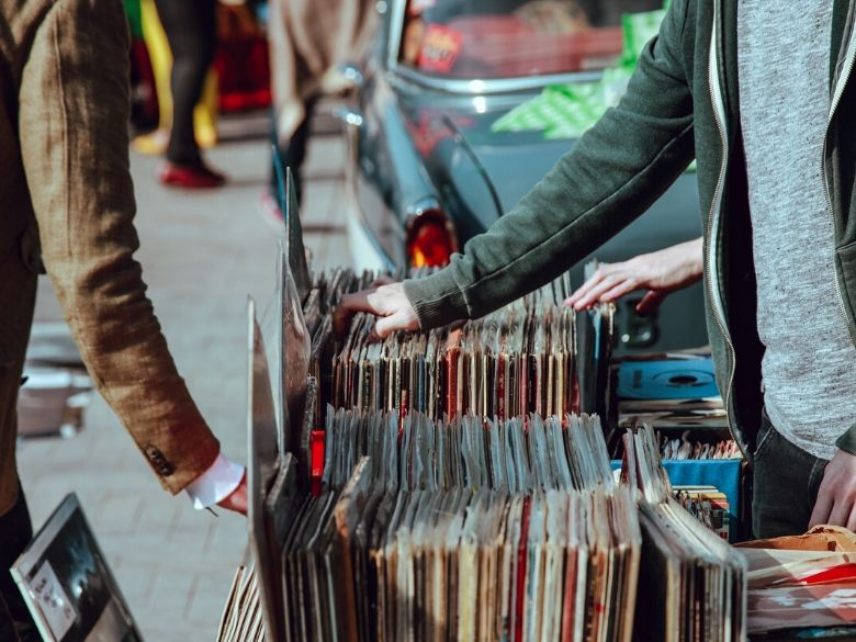 records being sold on a street corner
