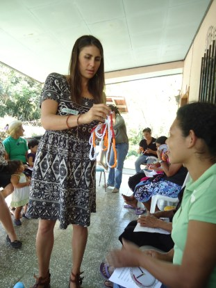 Volunteer Doula Stephanie White Giving out heart beat counters.
