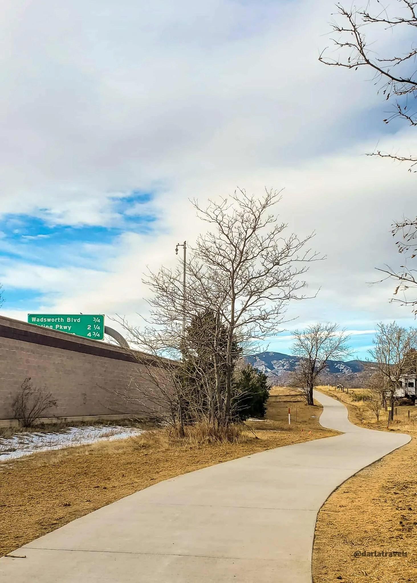 concrete trail heading toward the mountains