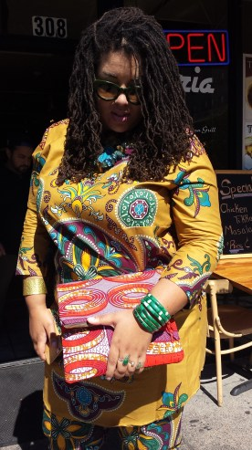 Fellow shopper, Anya, showing off her style. Top (part of a matching pant suit set) made in Ghana, price unknown; Clutch by LoveIguehi - $45.00