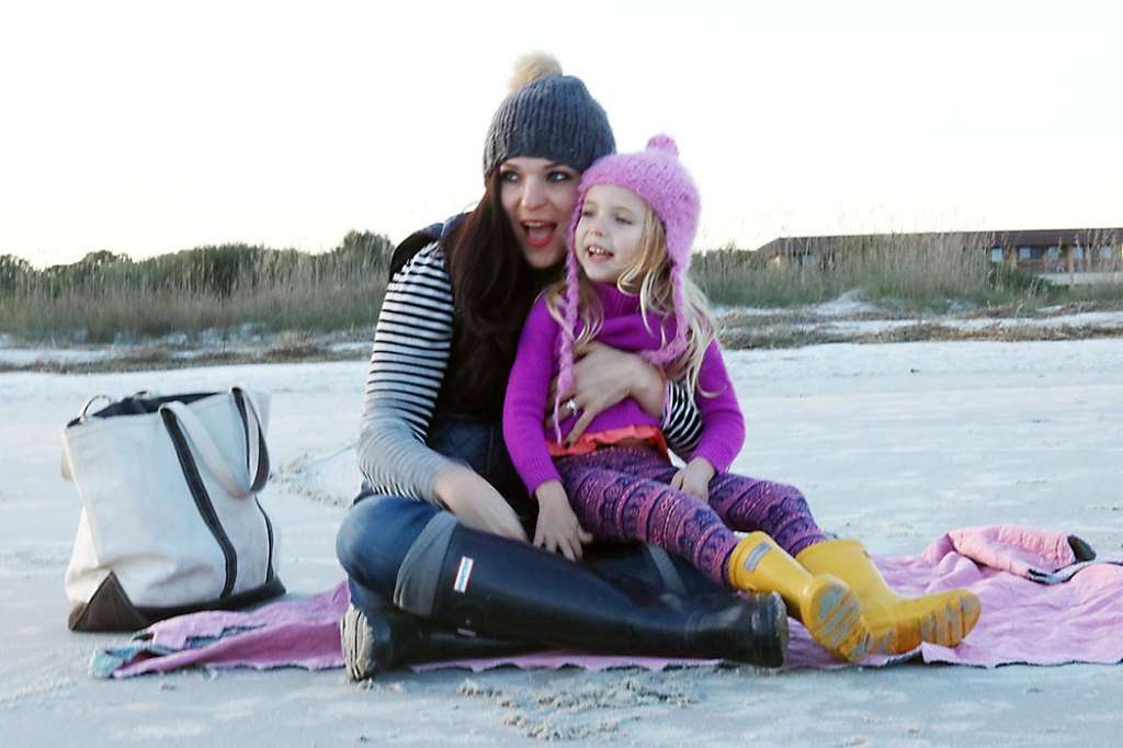 beach-outfit-sitting-on-the-sand-with-child