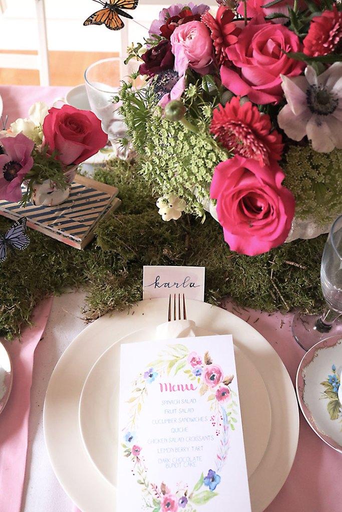 garden-party-menu, garden-tea-party-inside, garden tea party, outside garden party, table decorations, flowers, flower arrangements, butterfly, whimiscal, Alice in Wonderland, english tea party, centerpieces, secret garden