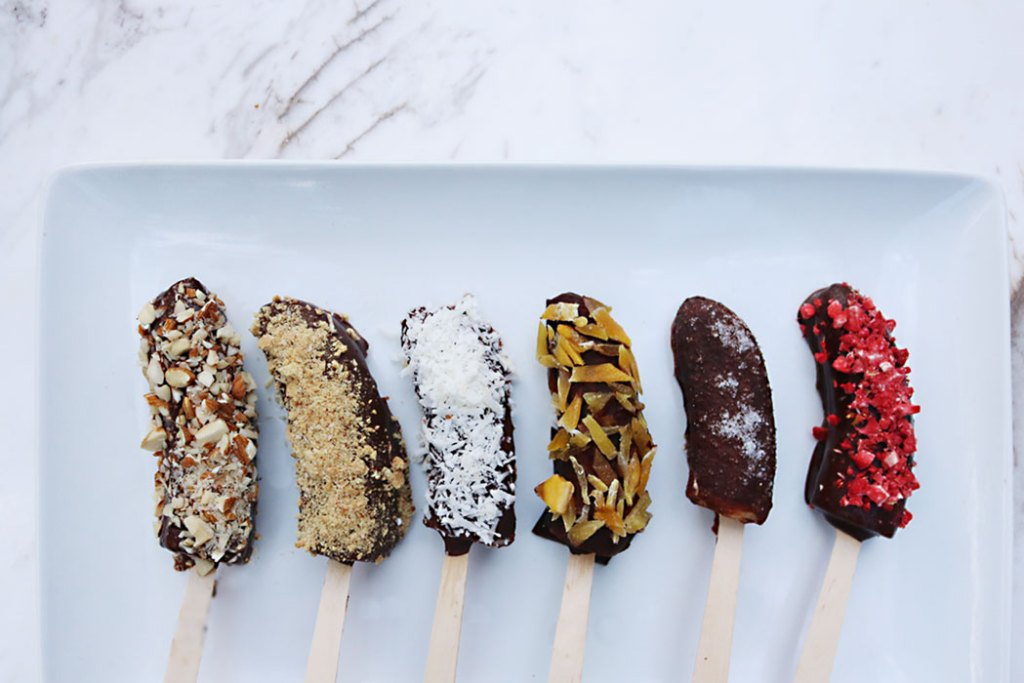 frozen-chocolate-banana-pops, raw cacao syrup, healthy chocolate banana pops, toppings, healthy toppings, coconuts, almonds, granola, salt and sweet