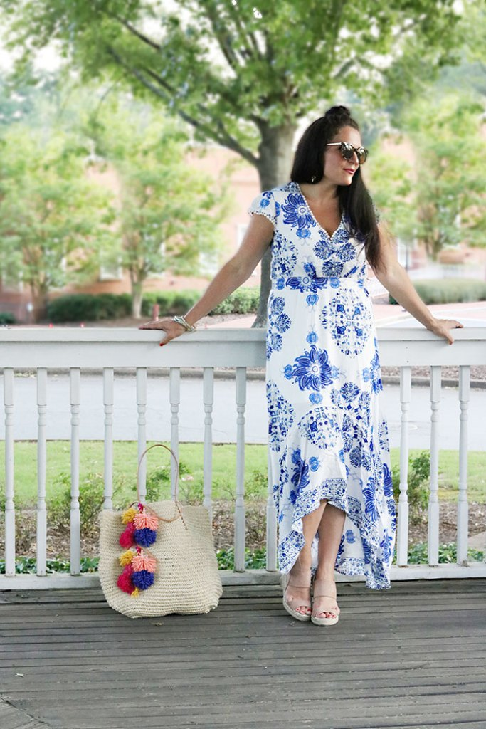 pom-pom-bag-with-blue-floral-dress