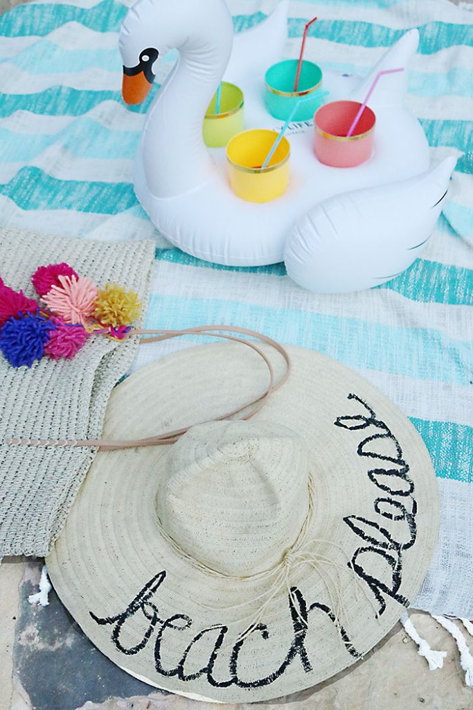 diy-word-script-straw-hat-at-pool, beach hat diy, diy summer project, straw beach hat, summer party favors, eugenia kim beach hat, script hat, phrase hat, beach straw hat