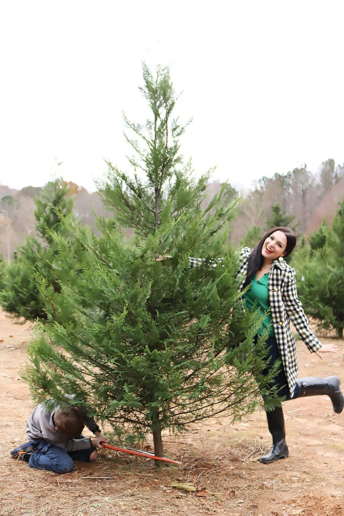 cutting-christmas-tree-down-posing, cutting our christmas tree outfit, southern tree farm, oxford coat, jcrew, hunter boots