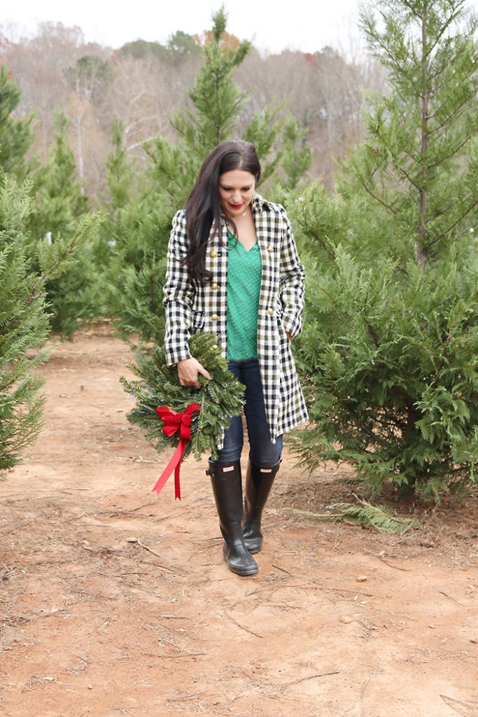cutting-christmas-tree-down-with-wreath