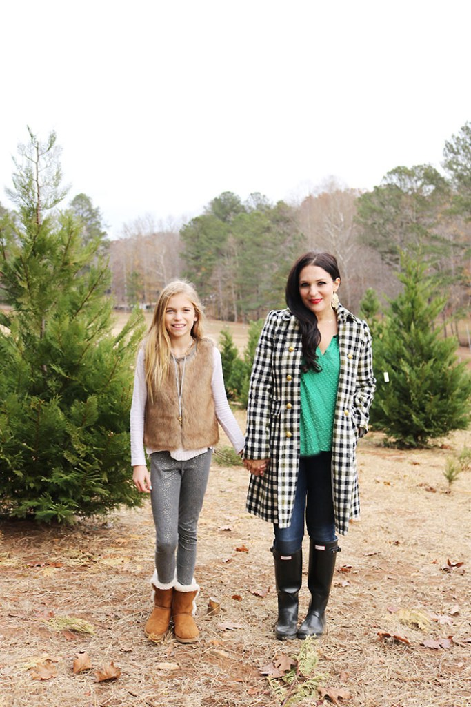 cutting-down-christmas-tree-mother-daughter, cutting down christmas tree family photography, christmas tree outfit, tree farm