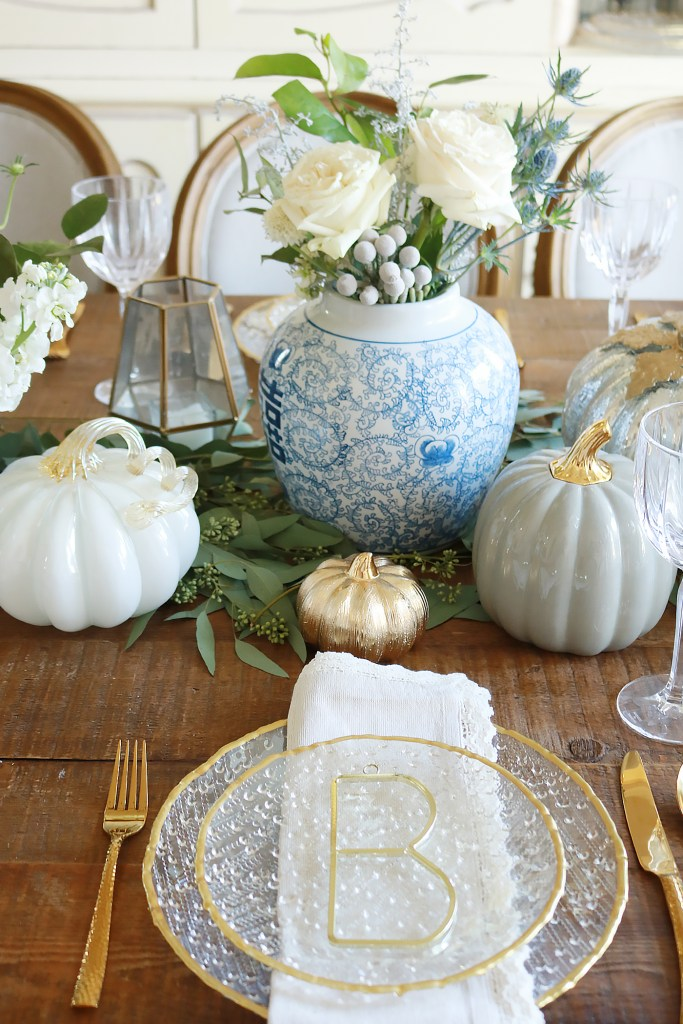 elegant thanksgiving table setting, chic thanksgiving table decorations, table setting pumpkins, thanksgiving flowers, thanksgiving geometric candle hurricane lanterns, gold table setting, thanksgiving tablescape, thanksgiving elegant rustic decorations, thanksgiving ideas, home goods table, pumpkin centerpieces, white pumpkin, thanksgiving dining room, beautiful thanksgiving, martha Stewart