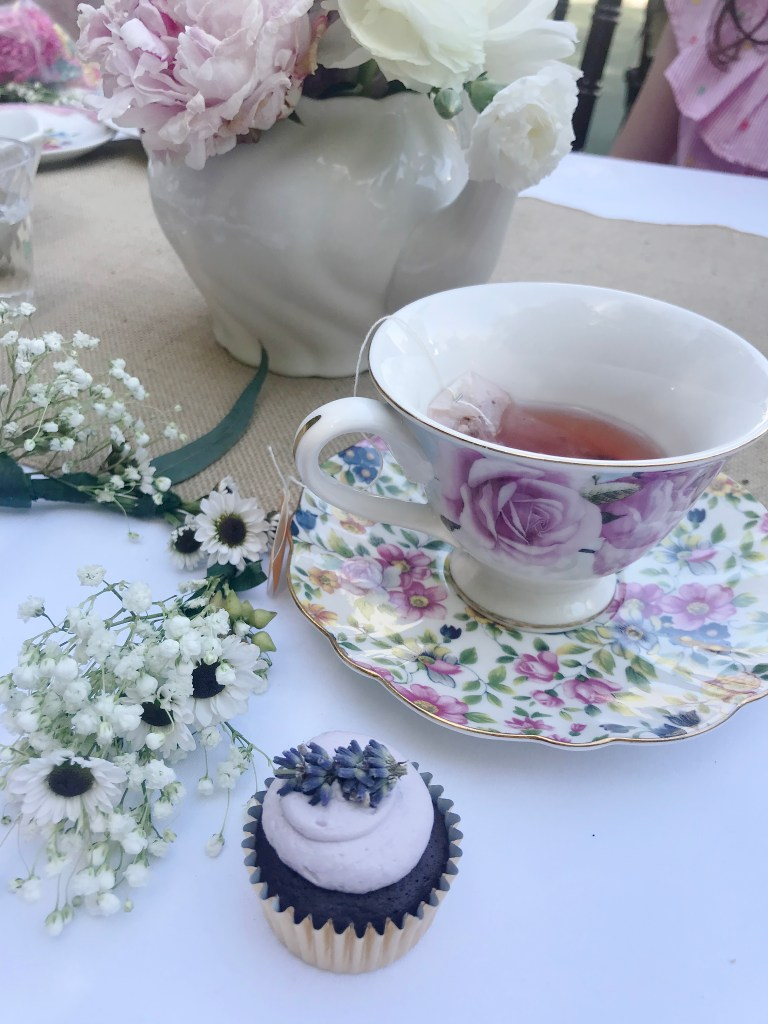 Hibiscus tea with pink peony flower arrangement in tea pot and flower crown and lavender chocolate cupcakes || Darling Darleen