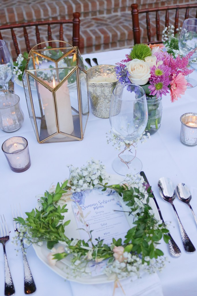 A summer solstice dinner party is the perfect way to gather friends and celebrate the longest summer day of the year and a good excuse to throw an elegant backyard celebration of midsummer.  Flower crowns table place setting.  The perfect summer menu|| Darling Darleen