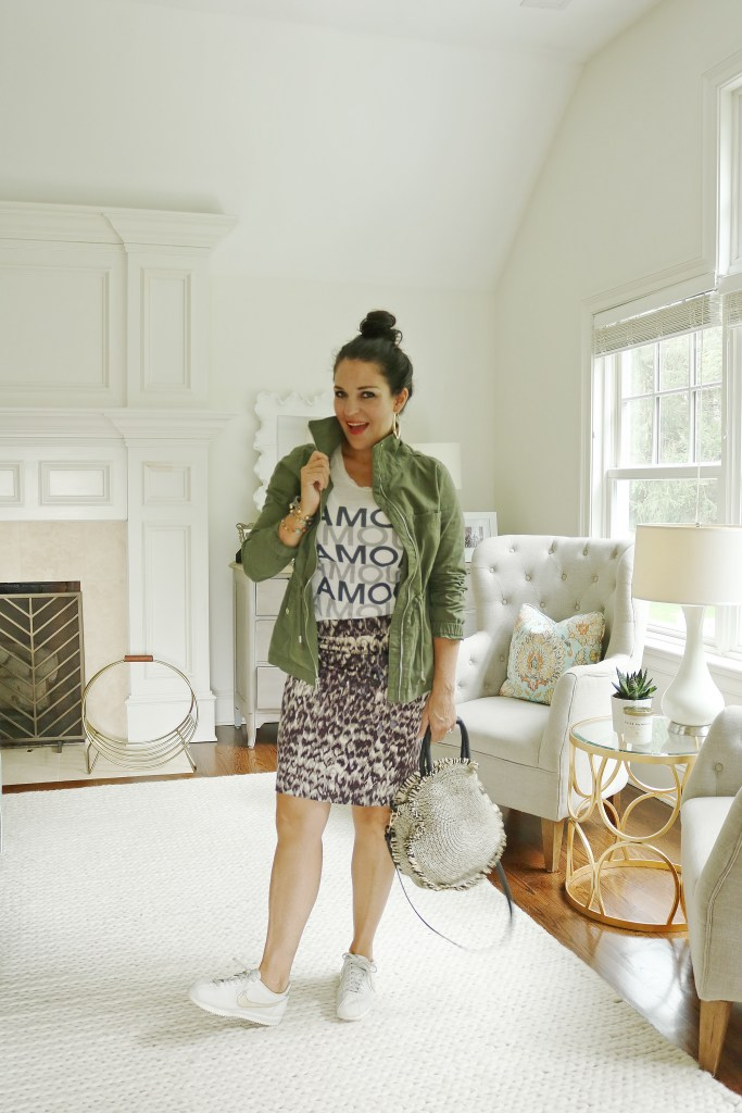 Wear your favorite Summer outfits all this Fall season.  Share the best transitioning summer outfits to fall like this leopard skirt and graphic t-shirt with a green cargo jacket. Fall outfit trend to wear || DarlingDarleen.com #falloutfits #falloutfittrend