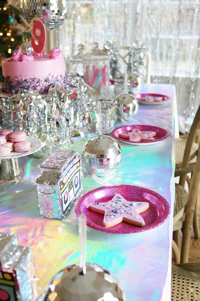 The cutest at-home Rock Star Disco Birthday Party with lots of disco balls and metallic!  So fun for any 9 year old! The party guests loved the dance party and the taking pictures all dress up! || Darling Darleen #discoparty #rockstarbirthdayparty