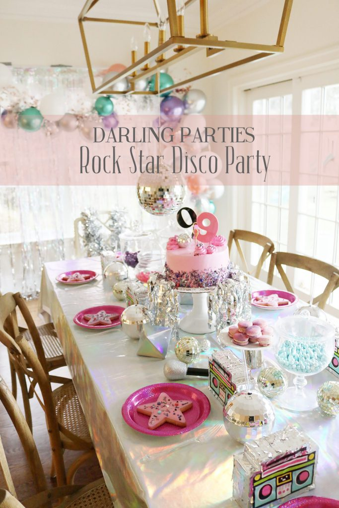 The cutest at-home Rock Star Disco Birthday Party with lots of disco balls and metallic!  So fun for any 9 year old! The party guests loved the dance party and the taking pictures all dress up! Darling Parties Rock Star Disco Party || Darling Darleen #discoparty #rockstarbirthdayparty