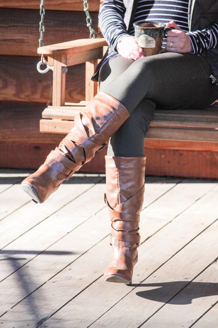Striped turtleneck, gray vest, olive pants, and cognac boots