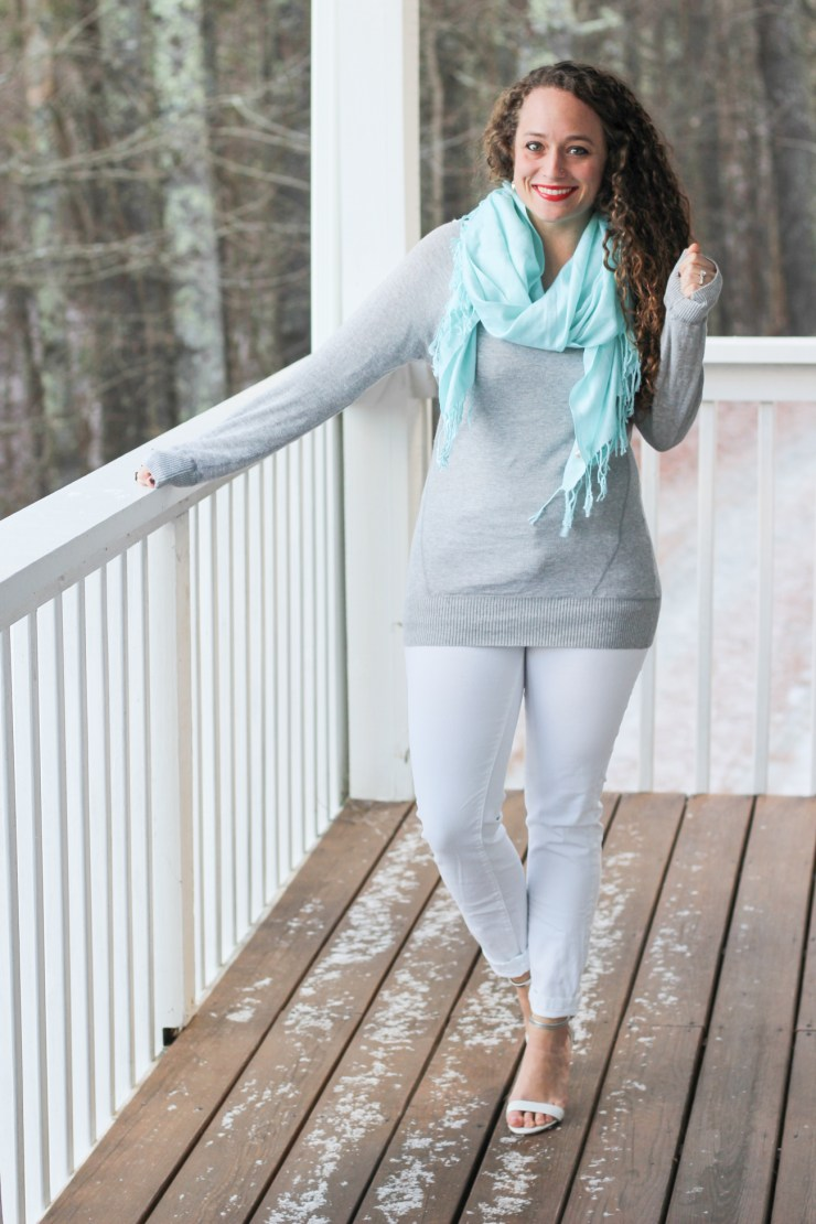 gray sweater, white pants, and light blue scarf