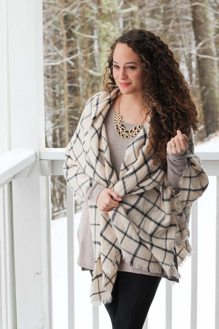 grid patterned blanket scarf, neutral sweater, leather leggings