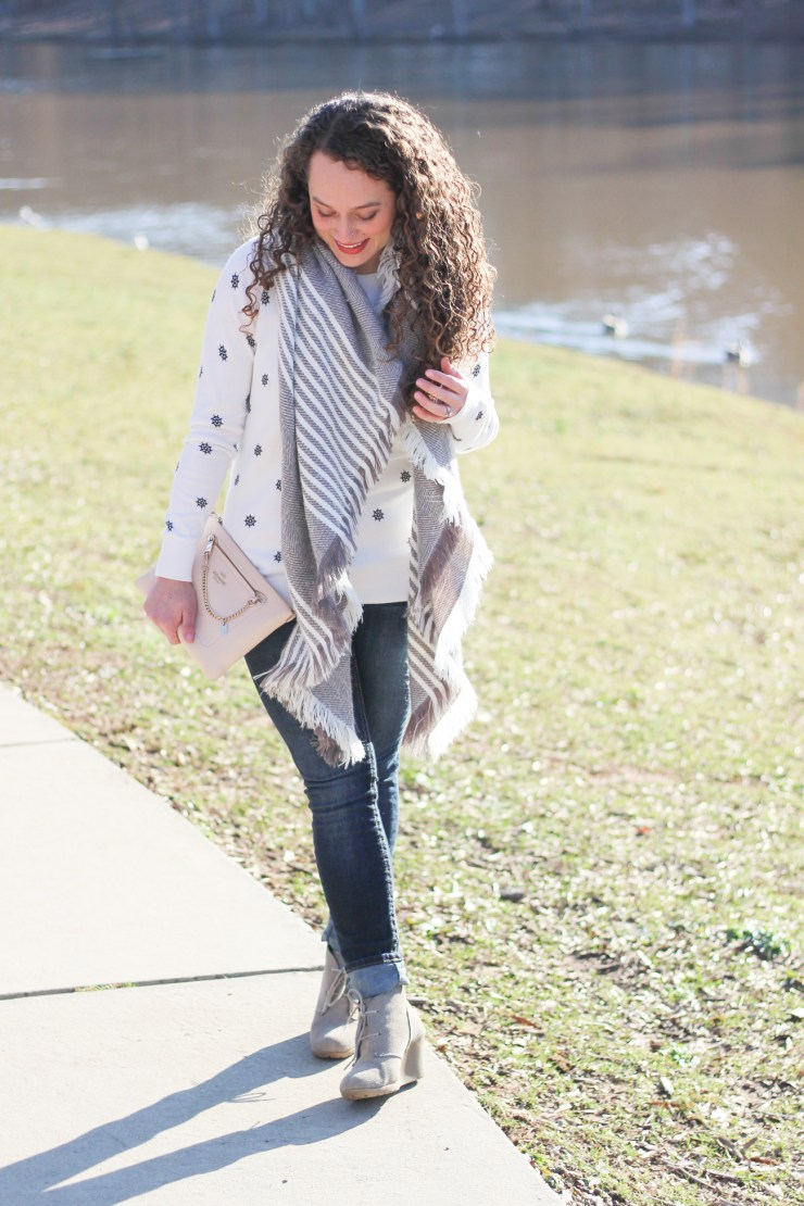gray and white blanket scarf styled for spring