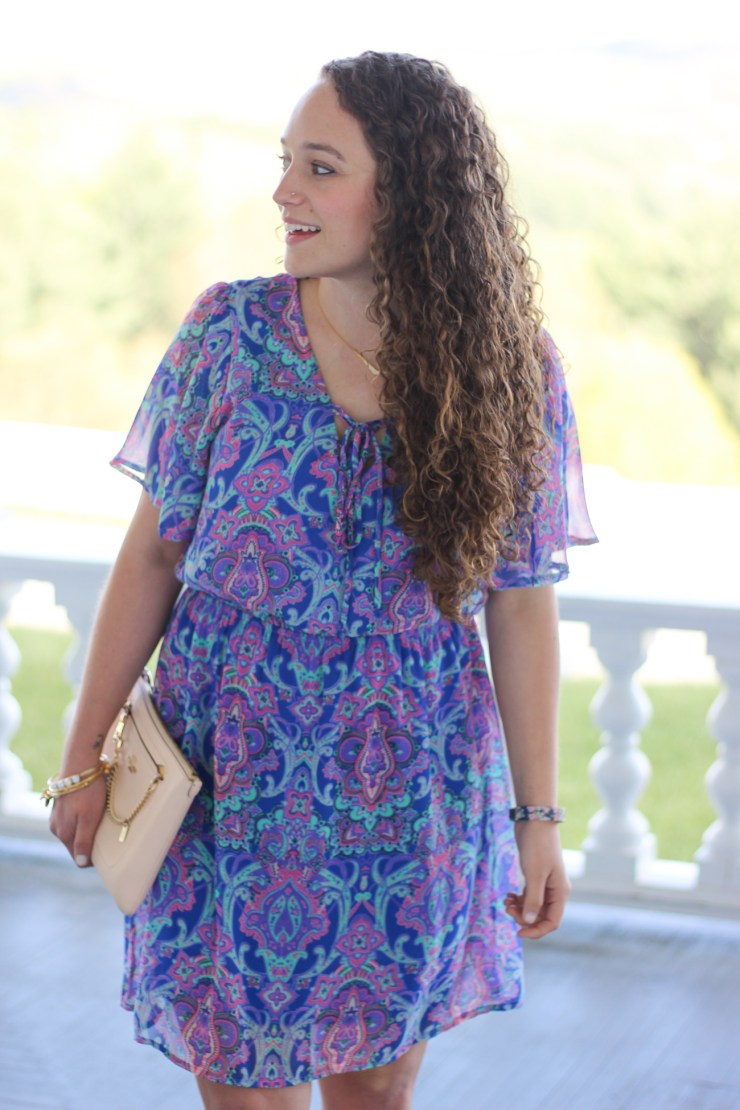 d.monaco bright colored print dress with a lace-up neck